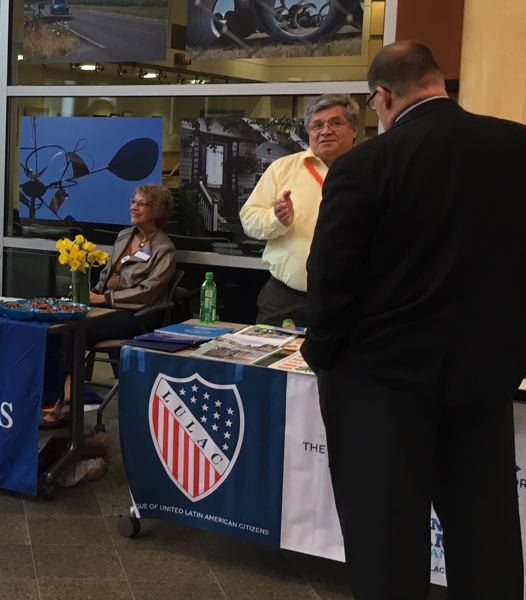 PAMPLIN MEDIA GROUP: PETER WONG - Luis Nava, who sits on the boards of the League of United Latin American Citizens and the League of Women Voters, talks with Washington County Commissioner Greg Malinowski at a candidate fair Thursday, April 5, at the Hillsboro Civic Center.