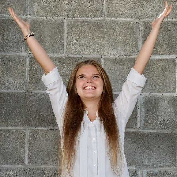 SUBMITTED PHOTO: COURTESY OF THE HEIDGERKEN FAMILY - Pastor David Sorensen called this photo, which graced the program cover at Nina Heidgerken's Celebration of Life on Sunday, 'a girl rejoicing.'