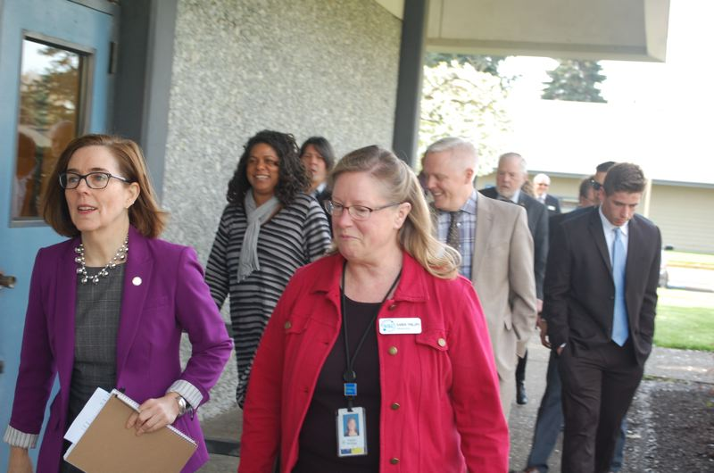 PHOTO BY: RAYMOND RENDLEMAN - Gov. Kate Brown's tour on April 9 was led by Sabin-Schellenberg Professional Technical Center Principal Karen Phillips.