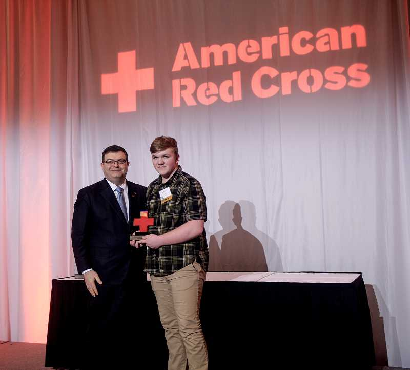 PHOTO COURTESY OF AMERICAN RED CROSS - Zach Rodgers received the Youth Good Samaritan Hero Award from the American Red Cross on March 9.