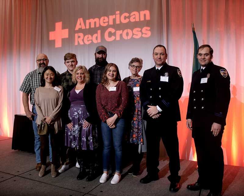 PHOTO COURTESY AMERICAN RED CROSS - Zach Rodgers is pictured with his family and Molalla Firefighters/Paramedics Rob Boren and Byron Wakefield.