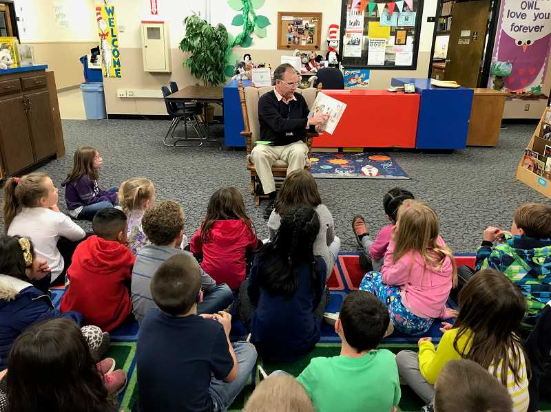 SUBMITTED PHOTO: CANBY SCHOOL DISTRICT - Superintendent Trip Goodall reads to the second grade students at Ninety One School on April 2.