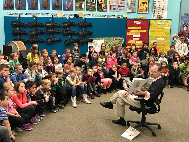 SUBMITTED PHOTO: CANBY SCHOOL DISTRICT - Superintendent Trip Goodall reads to the second grade students at Carus Elementary on April 2.
