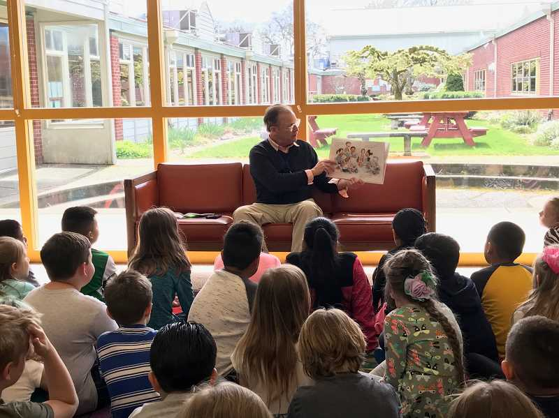 SUBMITTED PHOTO: CANBY SCHOOL DISTRICT - Superintendent Trip Goodall reads to the second grade students at Knight Elementary on April 2.