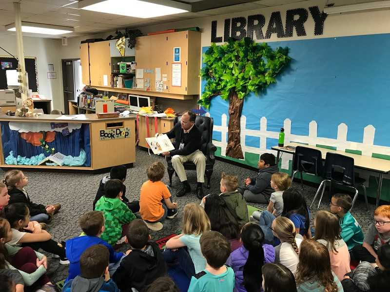 SUBMITTED PHOTO: CANBY SCHOOL DISTRICT - Superintendent Trip Goodall reads to the second grade students at Lee Elementary on April 2.