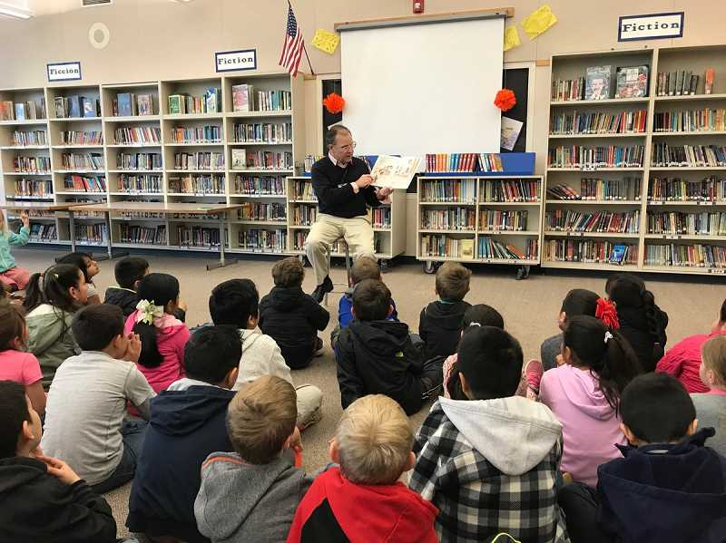 SUBMITTED PHOTO: CANBY SCHOOL DISTRICT - Superintendent Trip Goodall reads to the second grade students at Trost Elementary on April 2.