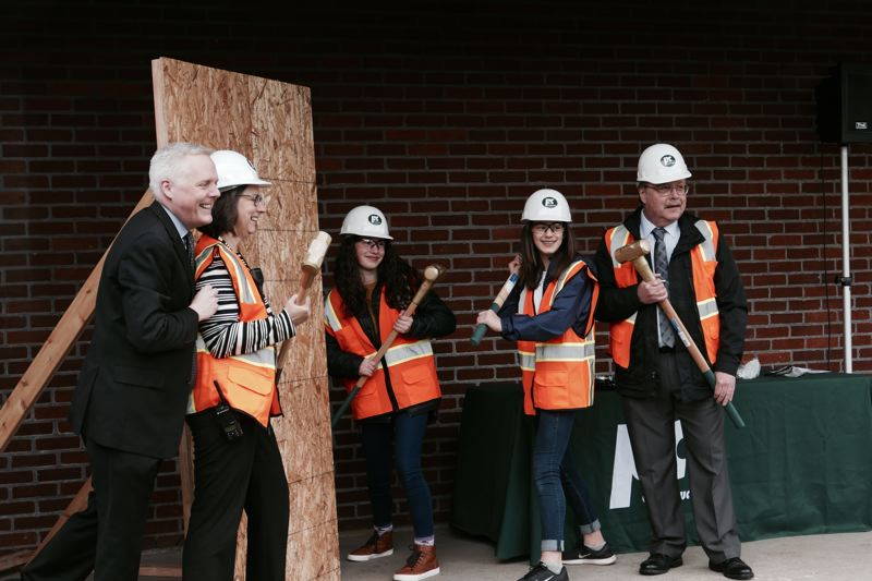 PHOTO COURTESY: JONATHAN HUTCHISON - Wielding the golden sledgehammers at the groundbreaking event for Alder Creek Middle School are (from left) Superintendent Matt Utterback, Principal Alyson Brant, students Emmie Reed and Anne Rust, and School Board Chair Rein Vaga.