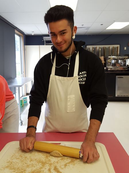 PHOTO COURTESY: LESLIE ROBINETTE - Gladstone High School senior Ben Perez makes flatbread in a new social studies class about the history and culture of food.