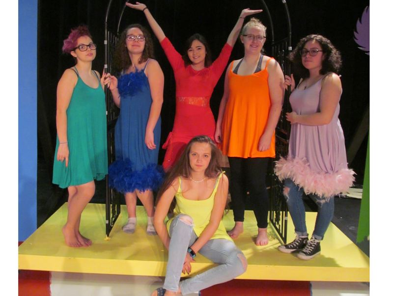 PHOTO BY ELLEN SPITALERI - Colorful birds are played by, left to right, Lola Habre, Morgan Biggs, Brandi Martin, Gail Van Stelle and Sariah Padroza. Seated, Ava Johnson.