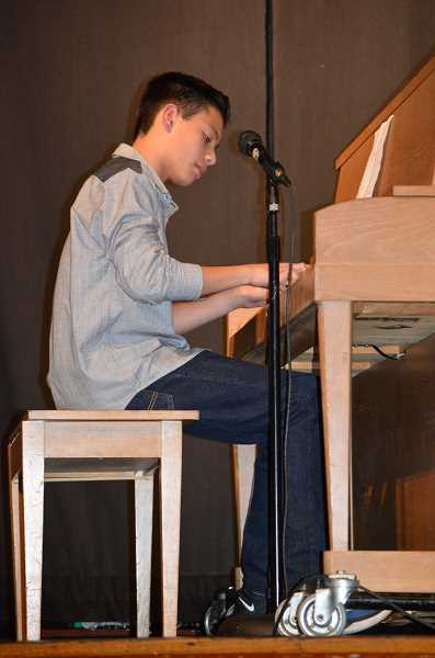 PIONEER PHOTO: CINDY FAMA - Javin GoDair, age 13, plays the piano and sings 'Perfect.'