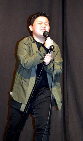 PIONEER PHOTO: CINDY FAMA - Eddie Rogers, age 11, leans into the mic during his performance at Stars on Stage.