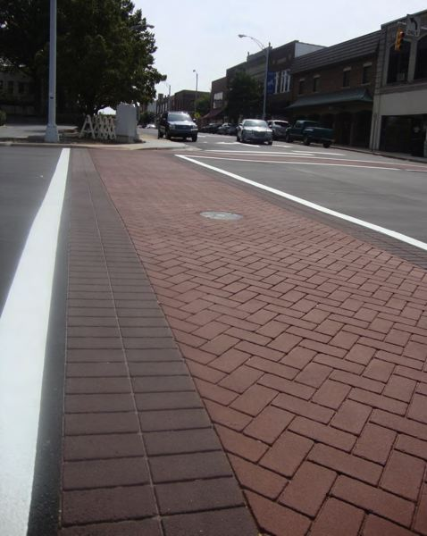 COURTESY PHOTO: CITY OF FOREST GROVE - City officials hope that by replacing worn decorative crosswalks with a design featuring real brick pavers rather than colored and stamped thermoplastic, they will greatly lengthen their lifespan while preserving both public safety and a sense of place in downtown Forest Grove.