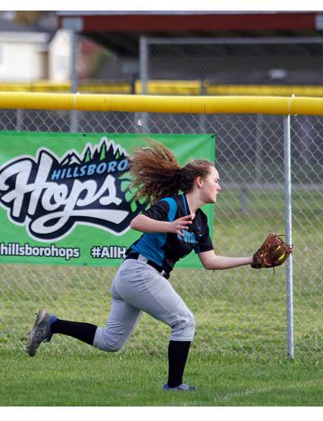 STAFF PHOTO: WADE EVANSON - Century freshman Hannah Hall makes a nice running catch during the Jaguars' game against Glencoe April 9 at Glencoe High School.