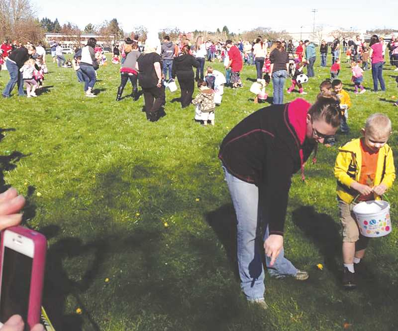 With a little direction from their parents, a nice crowd of youngsters hunted Easter eggs.