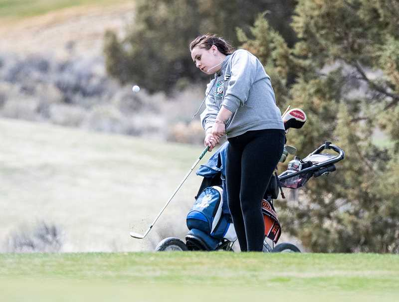 LON AUSTIN/CENTRAL OREGONIAN - Macy Goehring chips onto the eighth green at the Ridgeview Invitational Golf Tournament, which was held Friday at Juniper Golf Course in Redmond. Goehring finished with a score of 110 at the tournament.