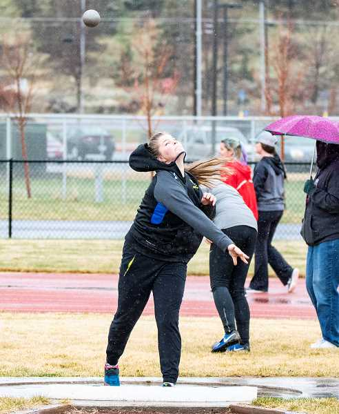 LON AUSTIN/CENTRAL OREGONIAN - Kenna Woodward throws the shot put on Thursday at Madras. Woodward won the event and then won again on Friday at Lake Oswego as the Cowgirls finished second in the nine-team meet.