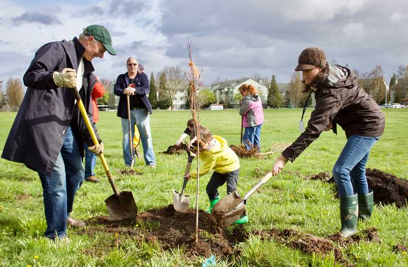 OUTLOOK PHOTO: CHRISTOPHER KEIZUR - Volunteers joined members of the Urban Forestry Subcommittee to plant trees at Gradin Community Sports Park Saturday, April 7.