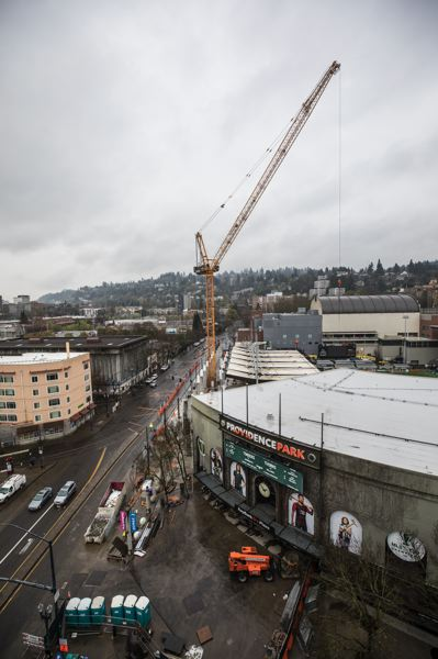 PAMPLIN MEDIA GROUP: JONATHAN HOUSE - Turner Construction's tower crane will dominate the scene this soccer season at Providence Park in downtown Portland.