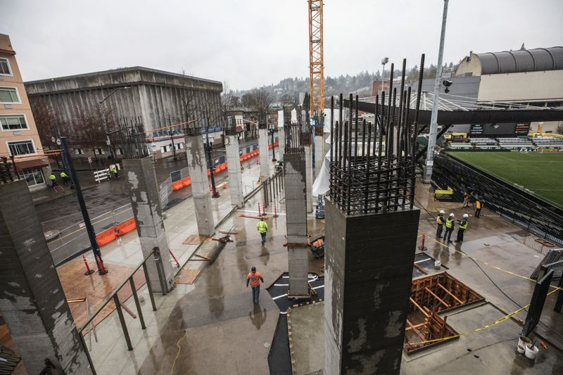 PAMPLIN MEDIA GROUP: JONATHAN HOUSE - Concrete and steel columns that will support and new seating levels on the Key Bank stand at Providence Park have risen since the end of last season. Construction of the new stand will continue over the season, but with stoppages for Timbers and Thorns home games, which begin April 14 and 15.