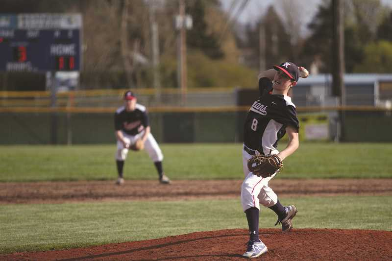PHIL HAWKINS - Freshman Dylan Kleinschmit delivers a pitch in the third inning of the win. This year's Trojan team is relying on a small group of seniors, like Valladares, to pave the way for the program's deep incoming underclassmen to thrive for the seasons to come.