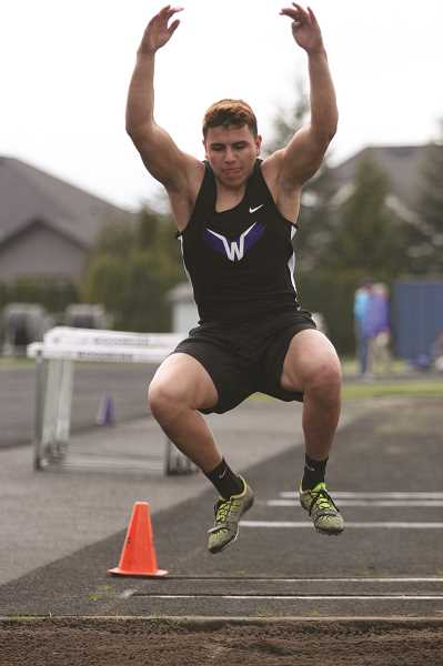 PHIL HAWKINS - Woodburn senior Chris Serrano, pictured at the Bulldogs' season-opening home track meet in March, placed first in the triple jump at Dallas.
