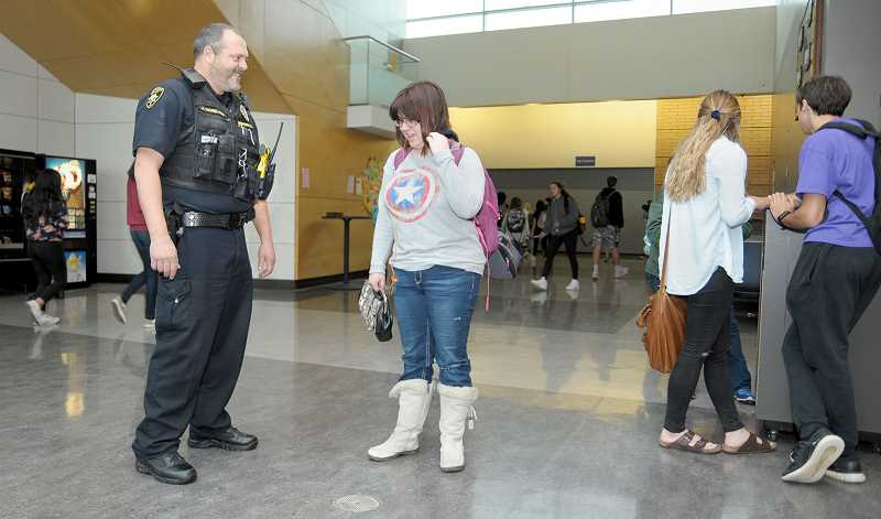 GARY ALLEN - School Resource Officer Jeff Moreland shares a laugh with a student last week at Newberg High School.