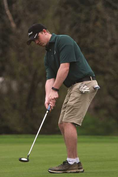 PHIL HAWKINS - North Marion senior Grant Hurst battled rainy conditions to finish third at the Huskies' home tournament last week with a score of 88.