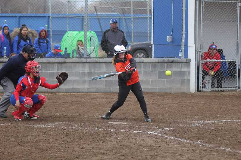 STEELE HAUGEN - Addison Finley connects with a hit against Madras JV.