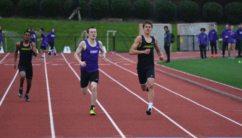 TIMES PHOTO: MATT SINGLEDECKER - Jesuit sophomore Sam Baricevic won the 400 meters against Sunset to help the Crusaders beat the Apollos.