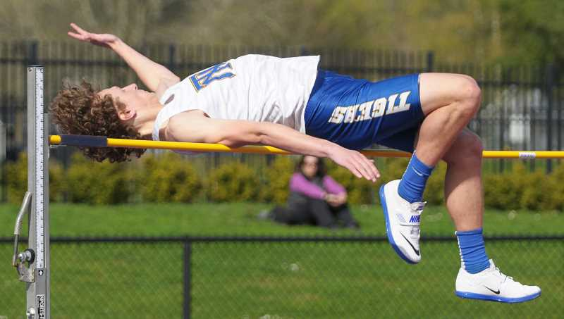 SETH GORDON - Mason Darling clears 5-10 to place fifth in the high jump at the Chehalem Track and Field Classic Friday at Newberg High School.