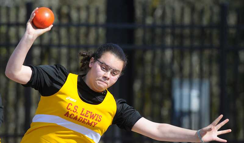 GARY ALLEN - Freshman Jamie Gooding heaves the shot put Friday at the C.S. Lewis Academy Invitational. Gooding placed fourth with a throw of 23-11.