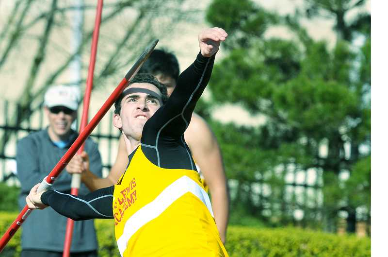 GARY ALLEN - Junior Trevor Ambrose throws the javelin the C.S. Lewis Academy Invitational Friday at George Fox University. It was the first meet the Watchmen have ever hosted. Ambrose won the javelin with a personal-record throw of 127-4.