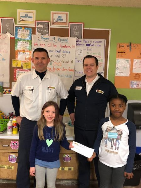 CONTRIBUTED PHOTO: PARKLANE ELEMENTARY SCHOOL  - Jared Thueson and David Ritchey from Les Schwab hand over a $500 check for the Pennies for Patients drive at Parklane Elementary School.