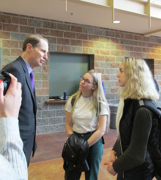 OUTLOOK PHOTO: TERESA CARSON - Reynolds High School senior Chloe Morrow, center, and junior Victoria Clark buttonholed Sen. Ron Wyden after his town hall, lobbying him to work to reduce the voting age to 16 from 18.