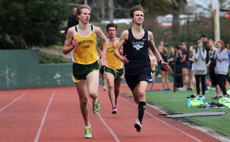 REVIEW PHOTO: MILES VANCE - West Linn junior John Wetzsteon (left) glances over at Lake Oswegos Eric Sasadeusz on the home stretch of the 1,500 meters during his teams 81-64 win over Lake Oswego at West Linn High School on April 4.