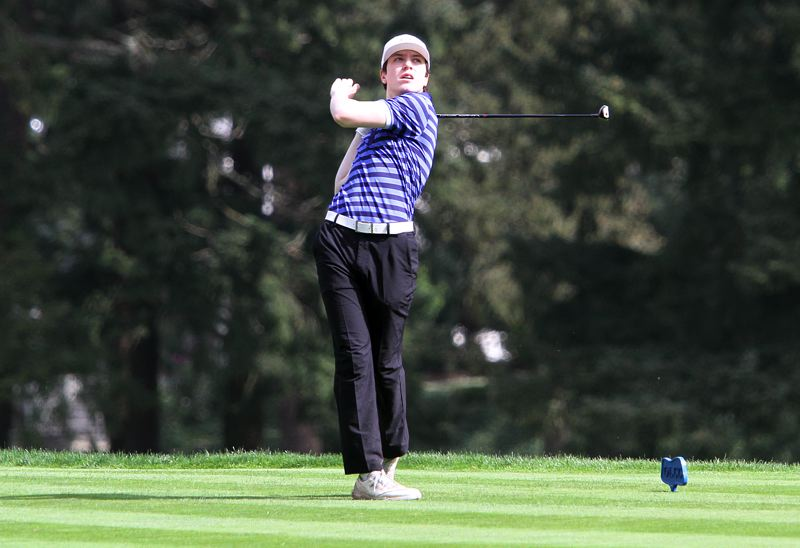 REVIEW PHOTO: MILES VANCE - Lake Oswego's Jacob Brumfield follows through after hitting a tee shot at Oswego Lake Country Club in Monday's Three Rivers League tournament.