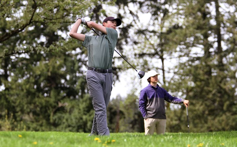 TIDINGS PHOTO: MILES VANCE - West Linn junior Sebastian Harden watches his tee shot fly during the Three Rivers League tournament at Oswego Lake Country Club on Monday.