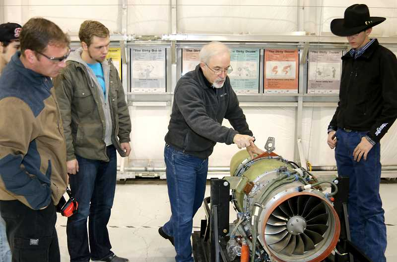 COURTESY PHOTO - Marshall Pryor, center, works with students at PCC Rock Creeks aviation maintenance program. The community college has a new partnership with Delta Air Lines.