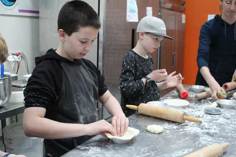 STAFF PHOTO: OLIVIA SINGER - Ffith graders Ryker Tovey and Benton Hughes participated in the pie class.