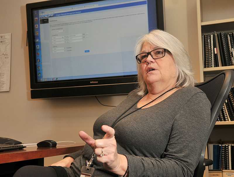 TIDINGS PHOTOS: VERN UYETAKE - West Linn Records Coordinator Teresa Zak is all-in when it comes to the City's HP TRIM program for public records management, and she says it benefits staff and residents alike.