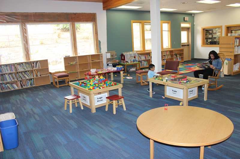 SPOKESMAN PHOTO: COREY BUCHANAN - Wilsonville's rennovated children's room features a more open spacious are in the middle of the room.