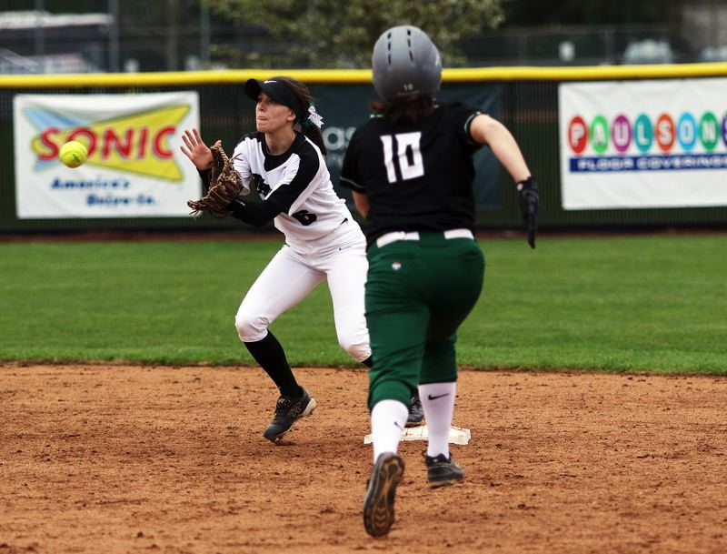 TIMES PHOTO: DAN BROOD  - Tigard High School junior shortstop Maddie Hoover (left) takes a throw for a force out at second base during the win over Reynolds.