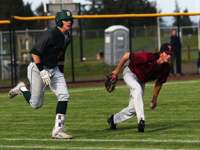 TIMES PHOTO: DAN BROOD - Tualatin senior pitcher Danny Shell (right) looks to make a toss to first after fielding a sacrifice bunt by West Linns J.J. Hoover during Mondays game.