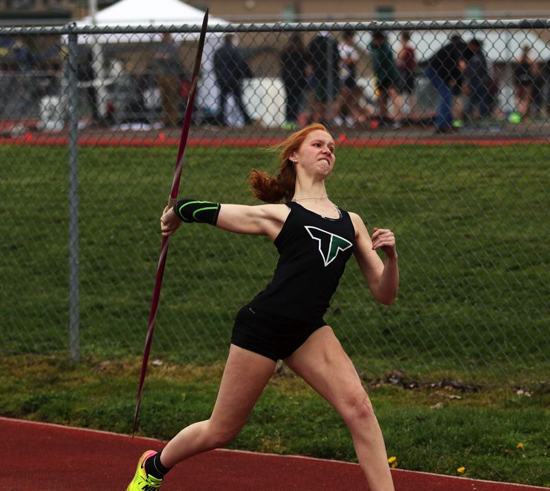 TIMES PHOTO: DAN BROOD - Tigard High School senior Lauren McFall triumphed in the javelin event during last weeks Three Rivers League meet at Tigard.