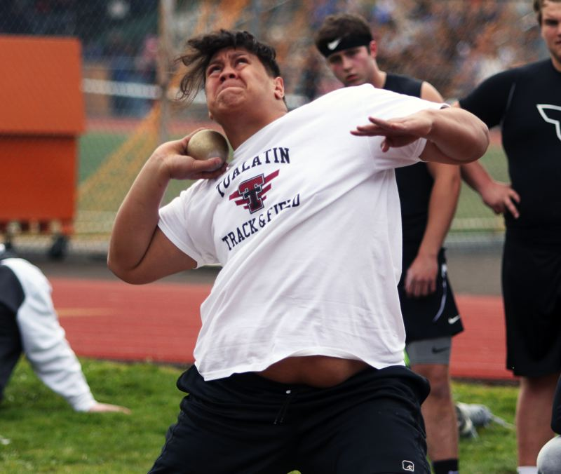 TIMES PHOTO: DAN BROOD - Tualatin High School senior Gerald Saina won the shot put event with a personal-best throw of 52-7 in last weeks meet at Tigard.