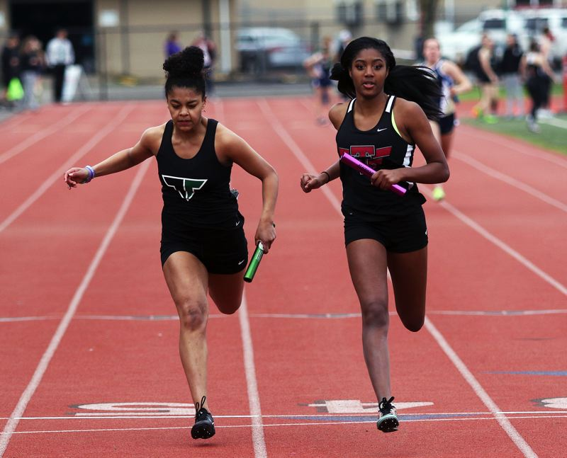 TIMES PHOTO: DAN BROOD - Tualatin senior Sierra Jones (right), shown here at the finish of the 4 x 100-meter relay, won both the long jump and triple jump at last week's meet at Tigard.