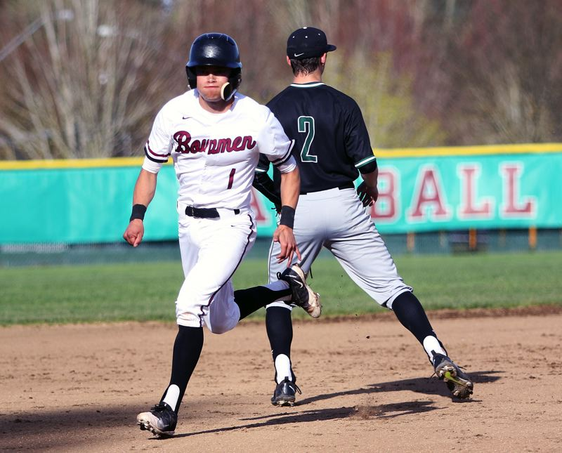 TIMES PHOTO: DAN BROOD - Sherwood junior Anthony Garrett (left) heads to third base during the Bowmen's home game with Tigard.