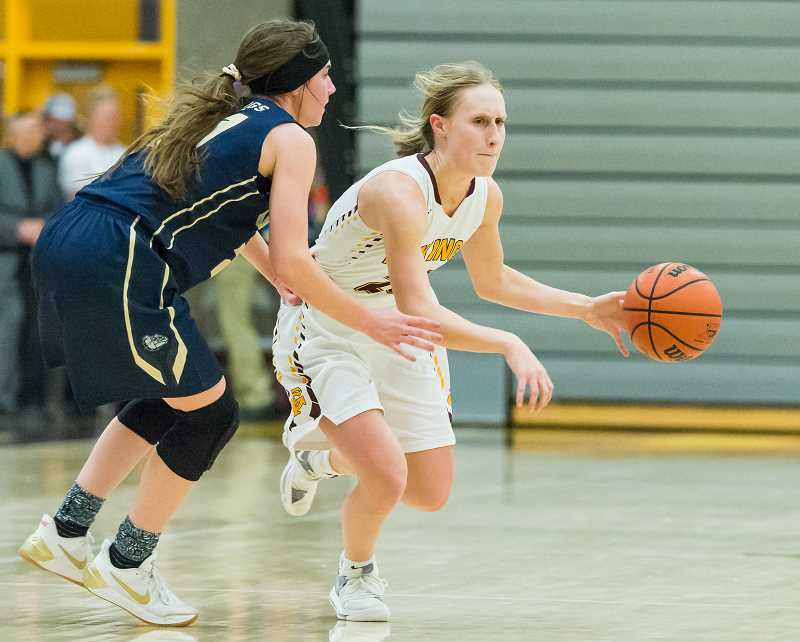 STAFF PHOTO: CHRISTOPHER OERTELL - Forest Grove's Katie Rebsom dribbles around a defender during a Viking basketball game last season. The Vikings were co-Greater Valley Conference champions in her final year at FGHS.