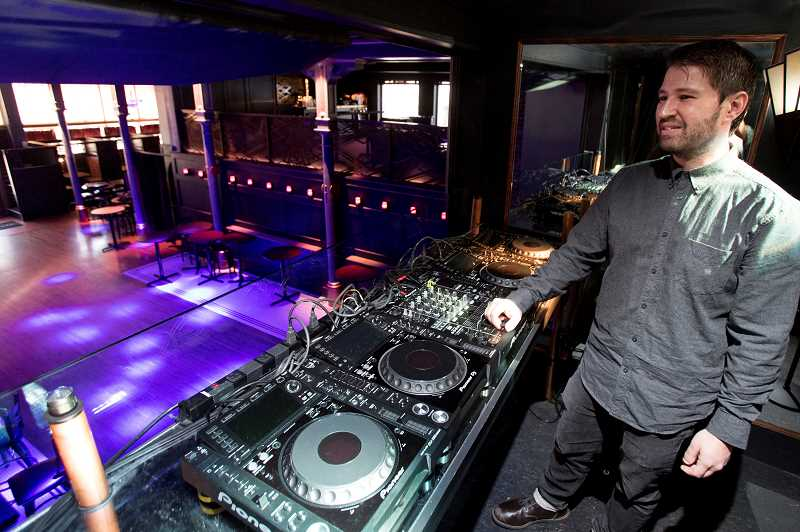 REVIEW PHOTO: JAIME VALDEZ - Lake Oswego-native Rick Sheinin stands in the DJ booth at the newly minted No Vacancy Lounge he and his partners opened early this year.