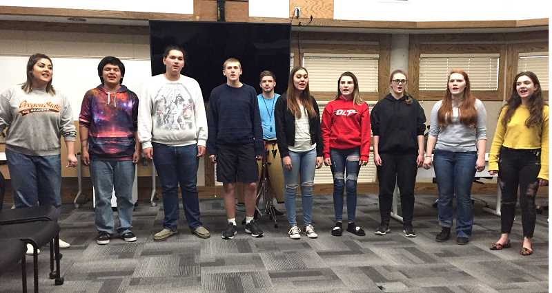 SUSAN MATHENY - Madras High School Chamber Choir members performing at the school board meeting included, from left, Gabby Nambo, Jasper Smith, Nacho Ruiz, Justin Plant, alumnus Greggory Vineyard (at back), Alexis Miller, McKenzie Brown, Emily Plant, Gabriella Armitage, and Allison Turek.